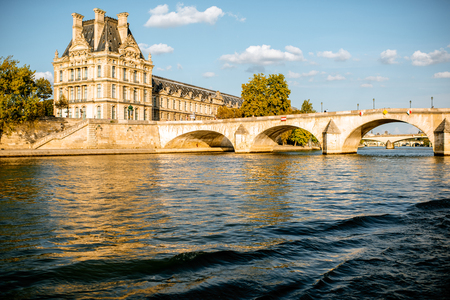 View on the riverside from the boat sailing on Seine river during the sunset in Paris Stockfoto