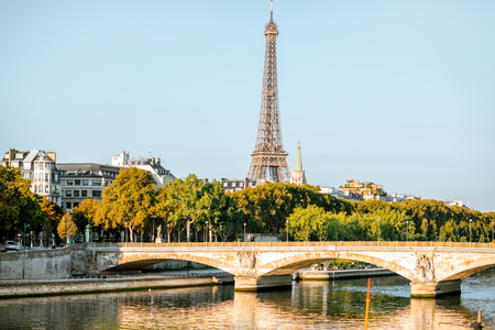 Landscape view of the riverside with Eiffel tower during the morning light in Paris Banco de Imagens
