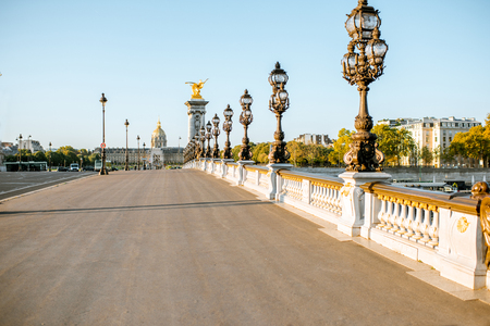 Alexandre bridge on Seine river with Residence of the Invalids on the background during the morning light in Paris