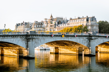 Landscape view of Concordia Bridge and residential buildings during the morning light in Paris