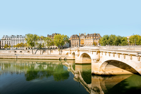 Landscape view of Seine river with Neuf bridge during the morning light in Paris