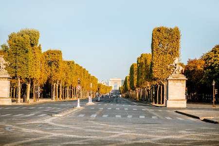 Street view of famous Elysian avenue during the morning light in Paris Фото со стока