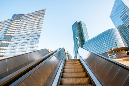 Morning view of the modern financial district with escalators outdoors in Paris