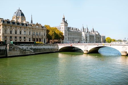 Landscape view of Seine river with Justice palace and stone bridge in Paris Stock Photo