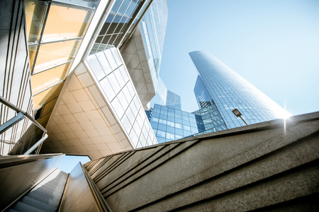 View from below on skyscrapers with escalator at La Defense financial district in Paris
