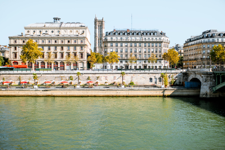 Landscape view on the riverside with saint Jacques tower in Paris Banco de Imagens