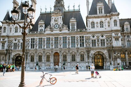 PARIS, FRANCE - September 01, 2018: City Hall building housing the City of Pariss administration with people on the square Editorial