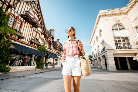 Beautiful woman walking at the old town of Deauville, famous french resort in Normandy