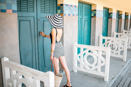 Beautiful woman near the old locker rooms on the beach in Deauville, famous french resort in Normandy Banque d'images - 110472418
