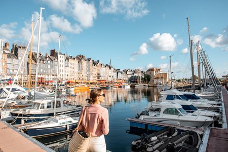 Young woman tourist enjoying beautiful view on the harbour traveling in Honfleur town in Normandy, France Reklamní fotografie