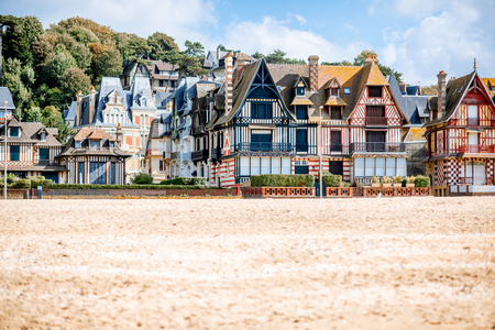 View on the cooastline with sandy beach and luxury buildings in Trouville, famous french town in Normandy Imagens