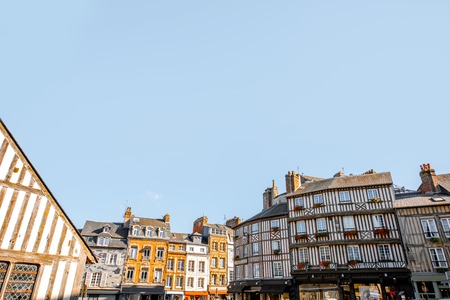 Beautiful facades of the old buildings in the central square in Honfleur, famous french town in Normandy. Wide angle view with copy space