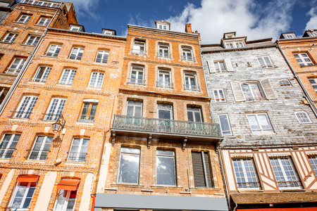 Beautiful facades of the old buildings at the harbour of Honfleur, famous french town in Normandy