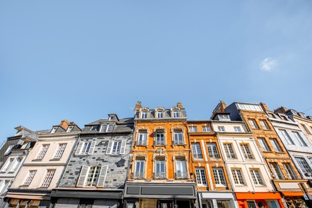 Beautiful facades of the old buildings in the central square in Honfleur, famous french town in Normandy