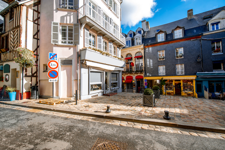 Street view with beautiful old buildings in Honfleur, famous french town in Normandy