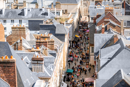 Aerial citysape view of Rouen with central pedestrian street crowded with people in Normandy, France