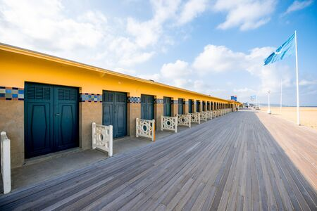DEAUVILLE, FRANCE - September 06, 2017: Landscape view of the beach with famous locker rooms dedicated to actors and movie makers who participated in Film Festival of Deauville