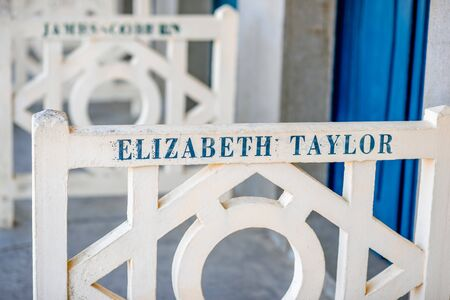 DEAUVILLE, FRANCE - September 06, 2017: Famous locker rooms on Planches promenade dedicated to Elizabeth Teylor, actors and movie makers who participated in Film Festival of Deauville Editorial