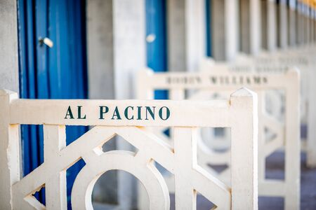DEAUVILLE, FRANCE - September 06, 2017: Famous locker rooms on Planches promenade dedicated to Al Pacino, actors and movie makers who participated in Film Festival of Deauville Editorial