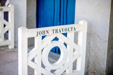 DEAUVILLE, FRANCE - September 06, 2017: Famous locker rooms on Planches promenade dedicated to John Travolta, actors and movie makers who participated in Film Festival of Deauville Sajtókép