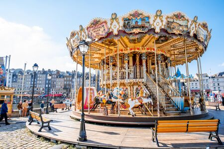 HONFLEUR, FRANCE - September 06, 2017: Circus carousel near the harbour of Honfleur, famous french town in Normandy Editorial