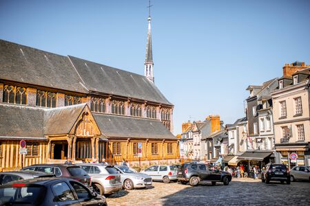 HONFLEUR, FRANCE - September 06, 2017: Street view wiith saint Catherine Old wooden church in Honfleur, famous french town in Normandy