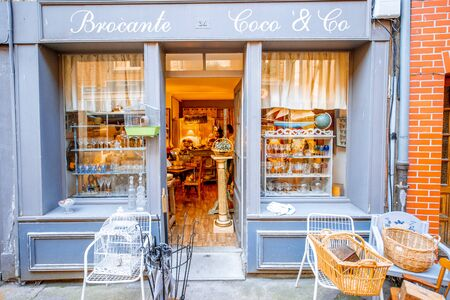 HONFLEUR, FRANCE - September 06, 2017: Street view with beautiful store front with furniture in Honfleur old town, normandy region in France 写真素材 - 127882647