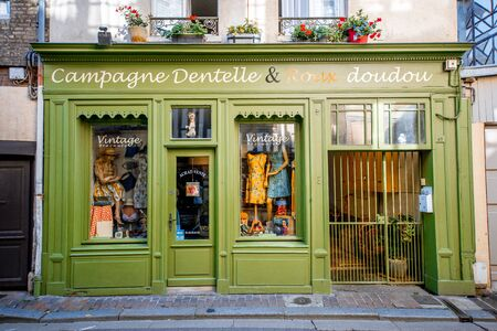 HONFLEUR, FRANCE - September 06, 2017: Street view with beautiful store front with clothes in Honfleur old town, normandy region in France Redactioneel