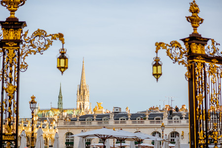 Cityscape view on the central square with beautiful Golden gates and cathedral tower in Nancy, France