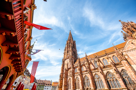 View from below on the main cathedral in the old town of Freiburg, Germany