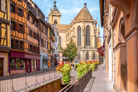 Cityscaspe view on the old town with saint Martin cathedral in Colmar, famous french town in Alsace region Stok Fotoğraf