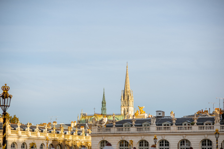 Cityscape view on the central square with beautiful buildings and cathedral tower in Nancy, France Stock Photo