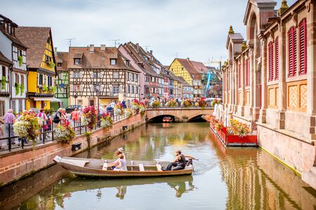 COLMAR, FRANCE - September 10, 2017: Cityscaspe view on the old town with beautiful half-timbered houses and water canal in Colmar, famous french town in Alsace region