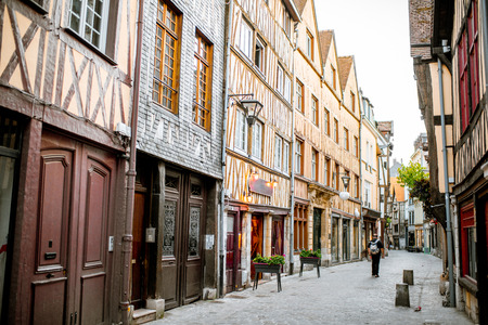 Ancient half-timbered houses on the street of the old town in Rouen city, the capital of Normandy region in France 写真素材