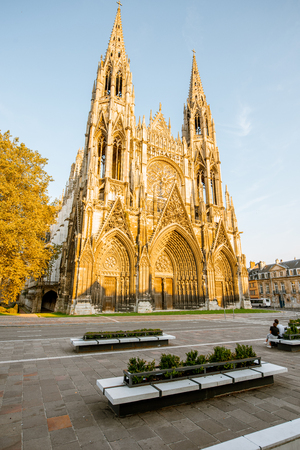 View on the gothic facade of the church of Saint-Ouen during the sunset in Rouen city, the capital of Normandy region in France