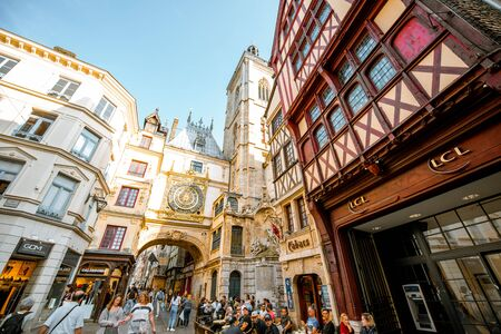 ROUEN, FRANCE - September 03, 2017: Crowded street with ancient buildings and Great clock on the renaissance arch, famous astronomical clock in Rouen, France Editorial