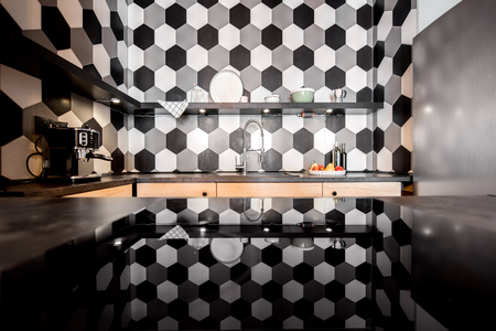 Loft kitchen interior with hexagonal black and white tiles 스톡 콘텐츠 - 113339356
