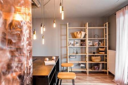 Modern loft dinning room made in pink and grey colors with copper wall Imagens