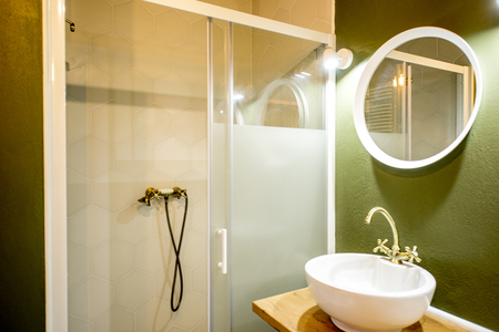 Modern loft bathroom made in green and white colors with retro plumbing elements