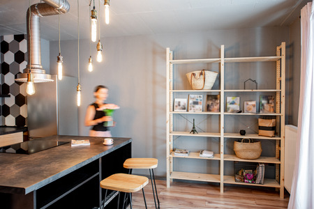 Modern loft dinning room with motion blurred woman doing housework