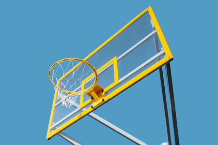 Close-up of a new basketball ring on the blue sky background