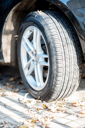 Close-up of a car wheel with alloy disk and summer tire on the street
