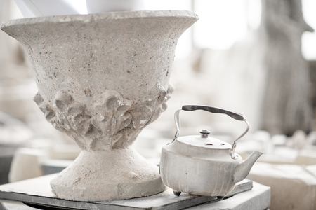 Old vase with teapot in the sculptors studio Stock Photo