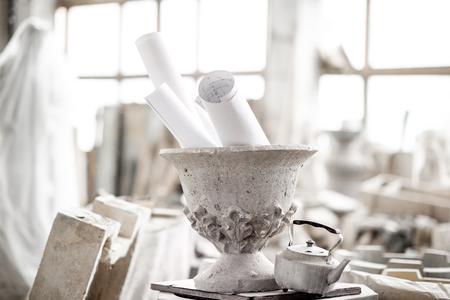Old vase with teapot in the sculptors studio 写真素材