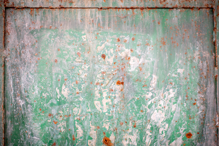 Old green rusted metal background