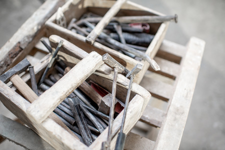 Sculptors working tools in the wooden boxes
