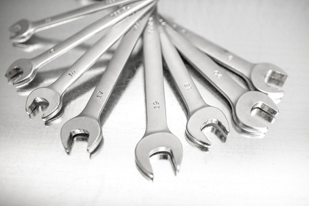 Pile of a new car wrenches on the stainless table Stock Photo
