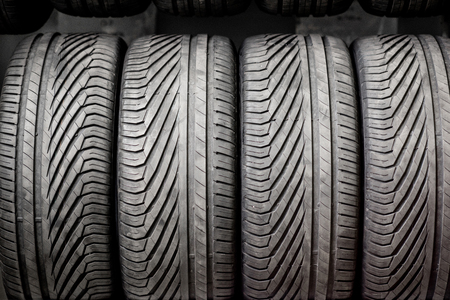 Close-up of a wheel protectors of summer tires at the warehouse 免版税图像