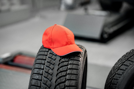 Red cap on the tire at the wheel mounting service Banco de Imagens