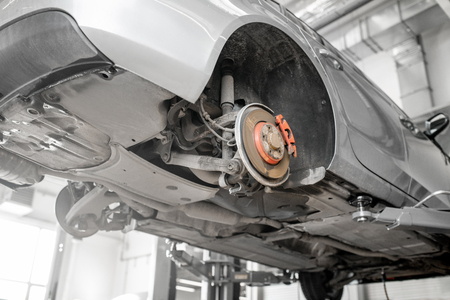 Car standing on the hoist during the diagnostics at the car service